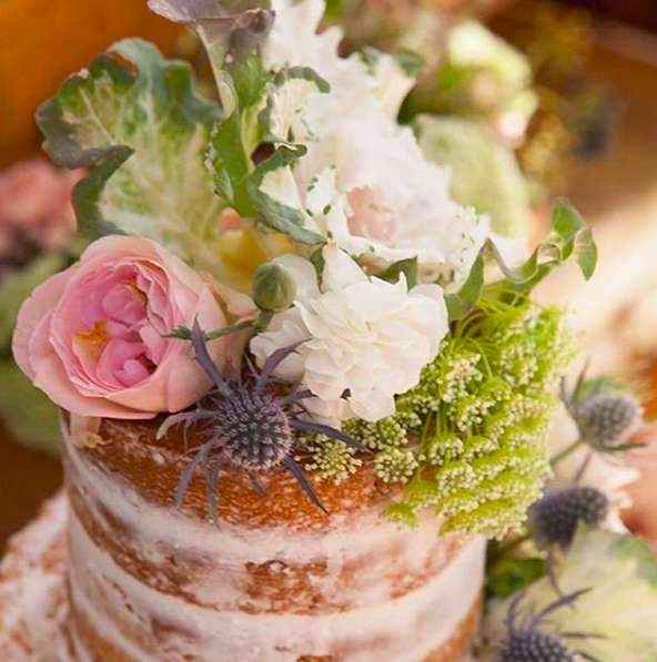 This cake is perfect for a rustic themed wedding. The semi-naked cake, decorated with native flowers.